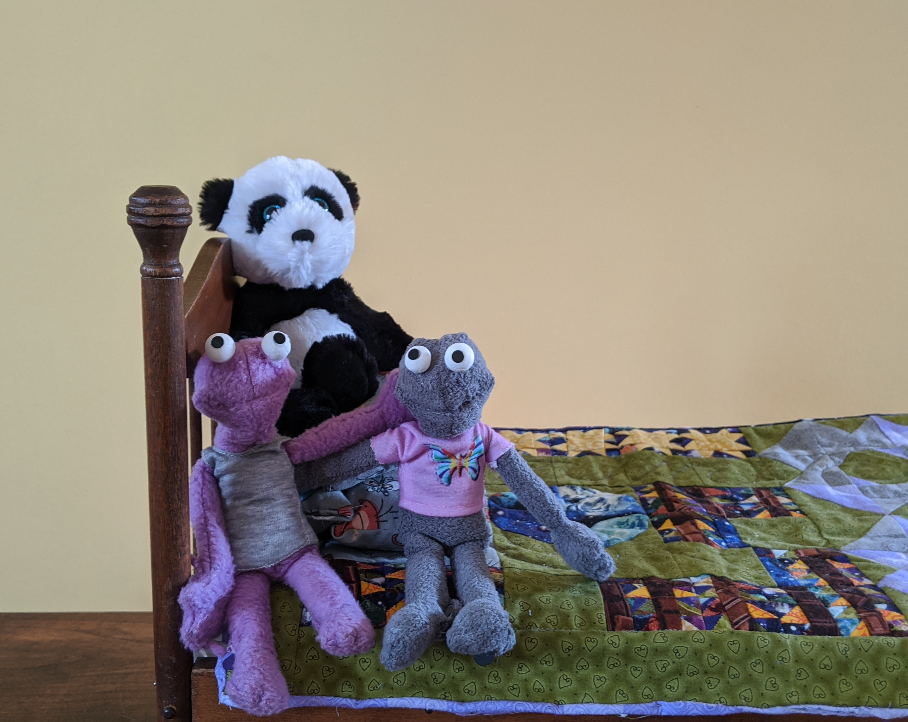 Pin and Jab and Bear sitting on their new quilt
